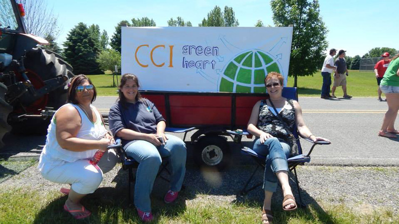 local coordinator in front of cci greenheart sign